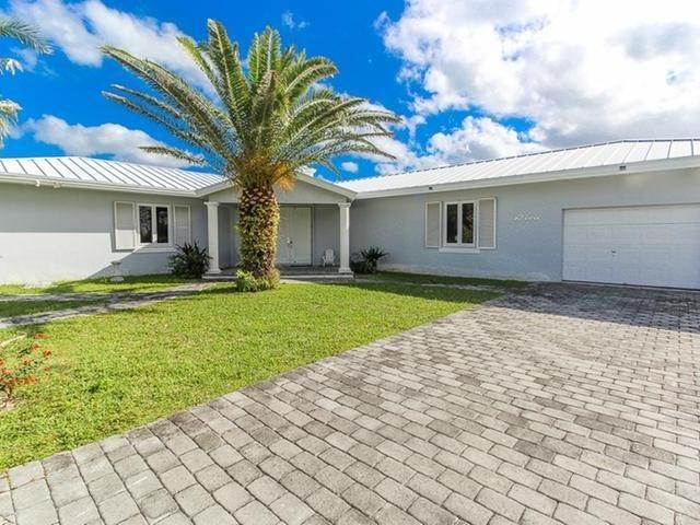 12. Single Family Homes por un Venta en Canal front home Fortune Bay, Gran Bahama Freeport, Bahamas