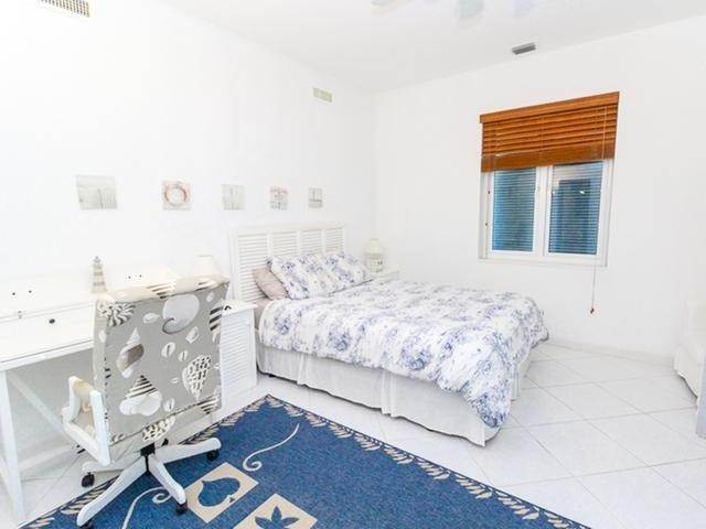 34. Single Family Homes por un Venta en Canal front home Fortune Bay, Gran Bahama Freeport, Bahamas