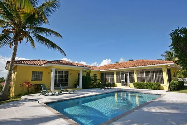 Single Family Homes for Sale at Fabulous Home on gated grounds with Pool Greening Glade, Freeport And Grand Bahama, Bahamas