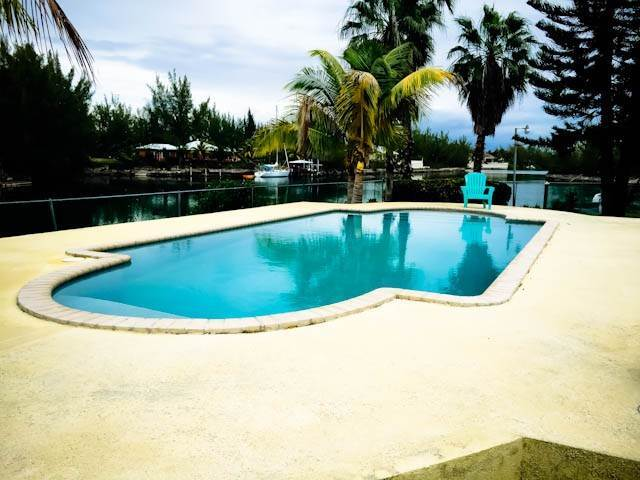 Single Family Homes for Sale at Fantastic canalfront home with guest house on point lot on Lagniappe in Fortune Bay Fortune Bay, Freeport And Grand Bahama, Bahamas