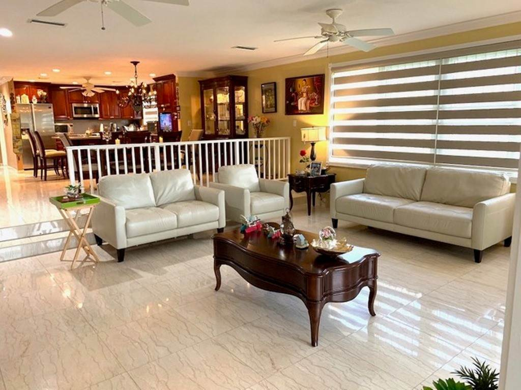 Co-op / Condo for Sale at Charming Waterfront Townhouse Bahamia Reef, Freeport And Grand Bahama, Bahamas