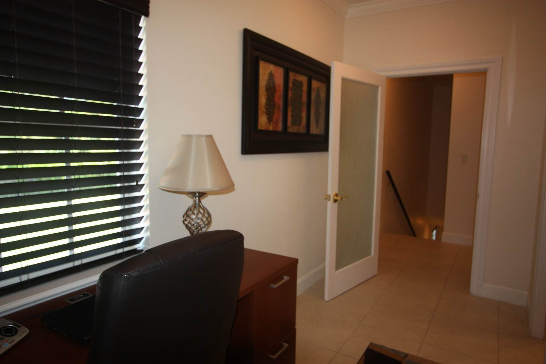 13. Co-op / Condo for Sale at Beautiful and Secure Canal Front Town House - The Hamptons Bahamia Marina, Freeport And Grand Bahama, Bahamas